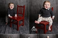 Little boy in red chair full of smiles