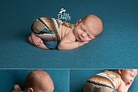 newborn in blue and brown romper