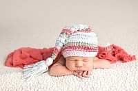 Chin on hands pose by DFW newborn Photographer