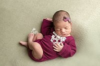 Newborn Baby Gril in Red Romper during Newborn Session