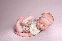 In-home newborn session with baby in lace outfit
