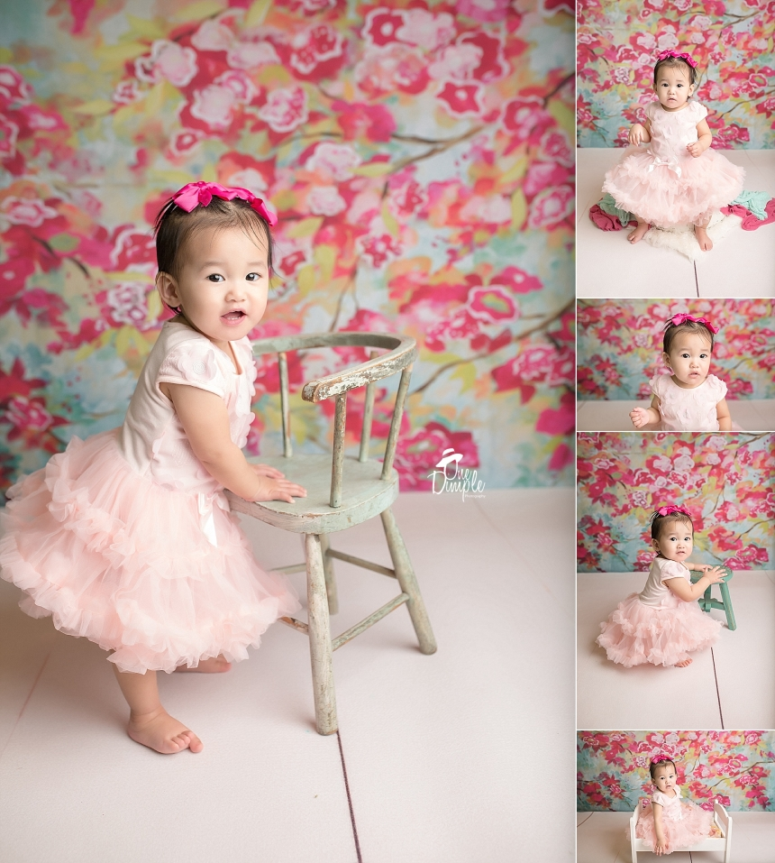 Floral backdrop with little girl celebrating 1st birthday