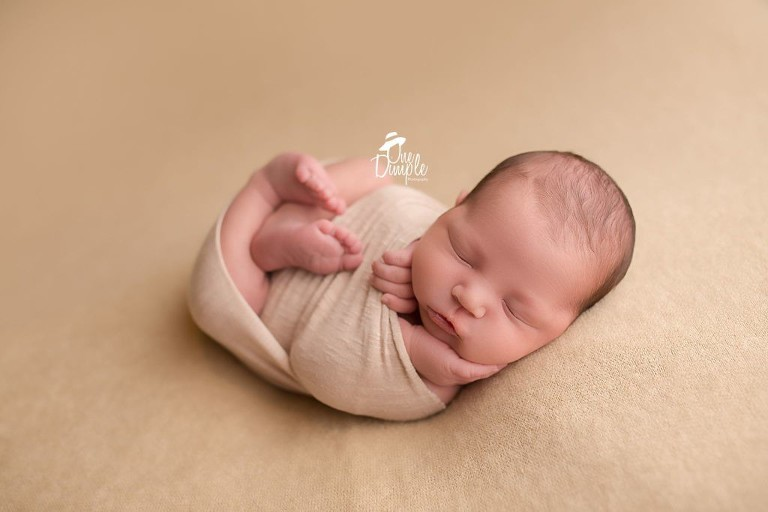 Dallas newborn photographer newborn in wrapped pose